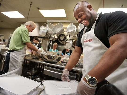 Martel Hixson (right) and Dana Driver joke around as volunteers gather in the commercial kitchen at Hope Church in Cordova to help assemble hundreds of meals for their kitchen ministry which sells the meals to church members and the public to raise money for charities all over the world. In it's 12th year, the Dinner on Demand program has raised over $1 million for the church's charity projects.