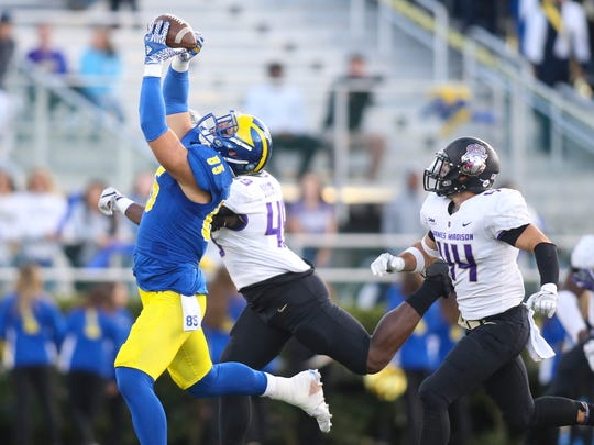 Delaware tight end Charles Scarff grabs a catch late in the fourth quarter of the Blue Hens' 20-10 loss  to JMU last year at Delaware Stadium.