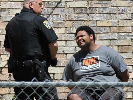 A Wichita Falls police officer stands with a possible
