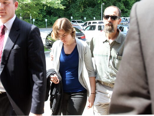 Lacey Spears is accompanied by her father, Terry, as she is led into a back door at Westchester County police headquarters in Hawthorne June 17, 2014.