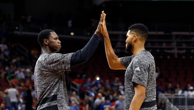 Minnesota's Gorgui Dieng and Karl-Anthony Towns during player introductions.  Oct. 15, 2016