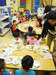 Children have lunch at the Puerto Rican Action Board