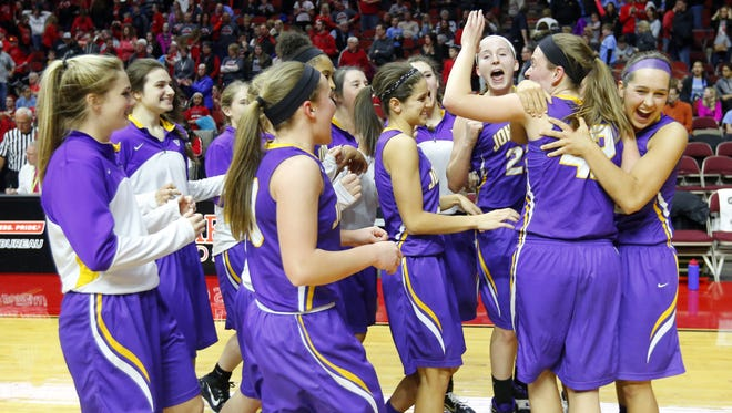 Johnston celebrates a win in the Class 5A Semifinal game with Linn-Mar Friday, March 4, 2016.