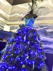 """Westwood Shores Waterfront Resort in Sturgeon Bay decorated this """"Peacock Tree'' for last year's Merry-Time Festival of Trees at the Door County Maritime Museum. This year's festival opens Nov. 11 and runs through Dec. 12."""