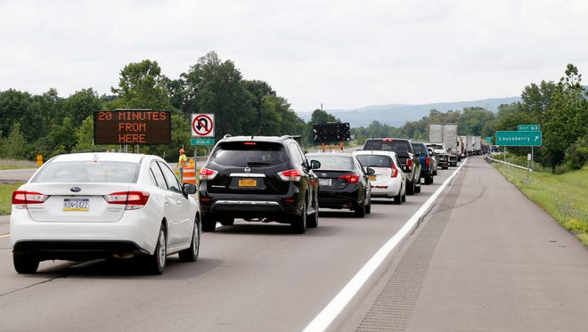 Traffic lines up to exit westbound Route 17 at exit 63 in the Town of Nichols due to a road closure on July 28.