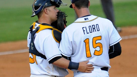 Montgomery Biscuits catcher Jake DePew talks with pitcher