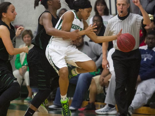Destanni Henderson of Fort Myers is fouled by Lakewood Ranch's Aleah Robinson in the closing minute.