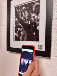 Reading the QR code on the photos takes you to a student