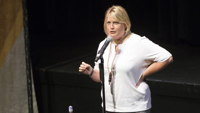 Kim Haasarud tells a story at Arizona Storytellers: Stories of Growing up at South Mountain Community College in Phoenix on Aug. 31, 2015.