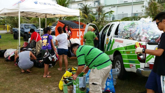 Peggy Denney from i*recycle Guam directs student volunteers for recycling at the Paddles Against Cancer event at Matapang Beach in Tumon on March 5, 2017.