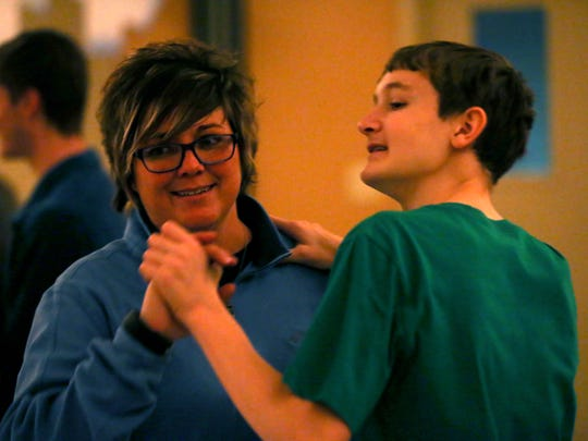 Diana Faulkner shares a dance with Jacob Crawford during a winter dance for special needs kids at the Southside Rec Center on Friday night.