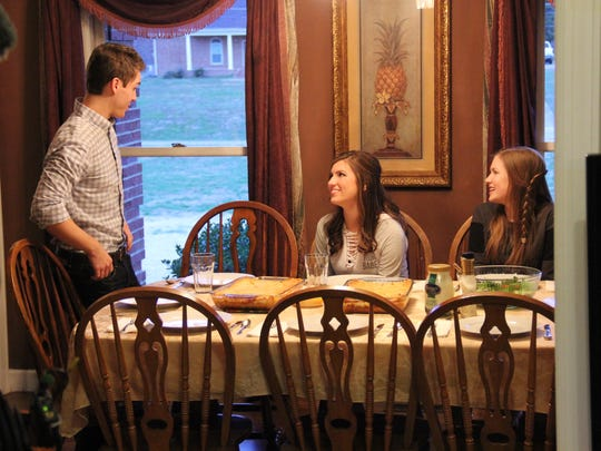 From left, Evan Stewart, Carlin Bates and Katie Bates spend time together at Stewart's home in Springfield, Tennessee.