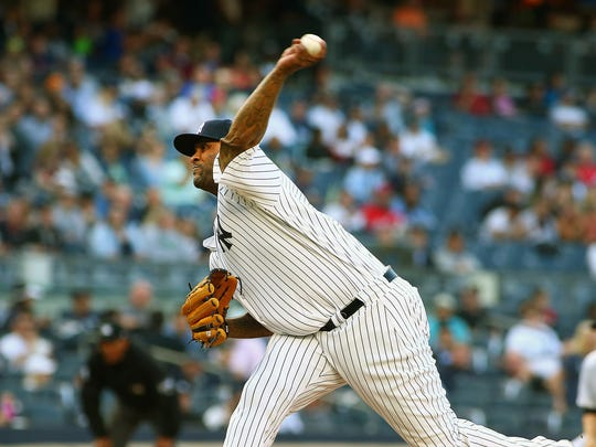 New York Yankees starting pitcher CC Sabathia (52) pitches against the Washington Nationals during the first inning at Yankee Stadium.