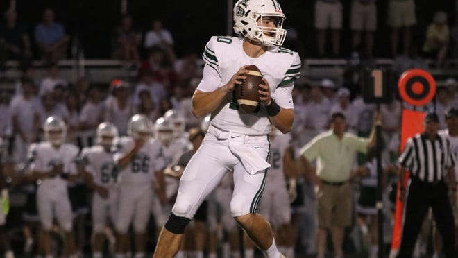 Athens Academy's Palmer Bush drops back to pass in the first quarter against Prince Avenue Christian last season.