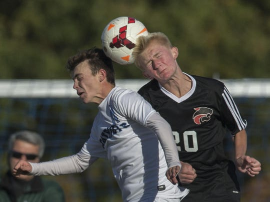 Freehold Township's Chris Orrico and Jackson Memorial's Chase Olejarz battle for a head ball during Jackson Memorial Boys Soccer vs Freehold Township in SCT tournament game in Freehold Twp on October 25, 2016.