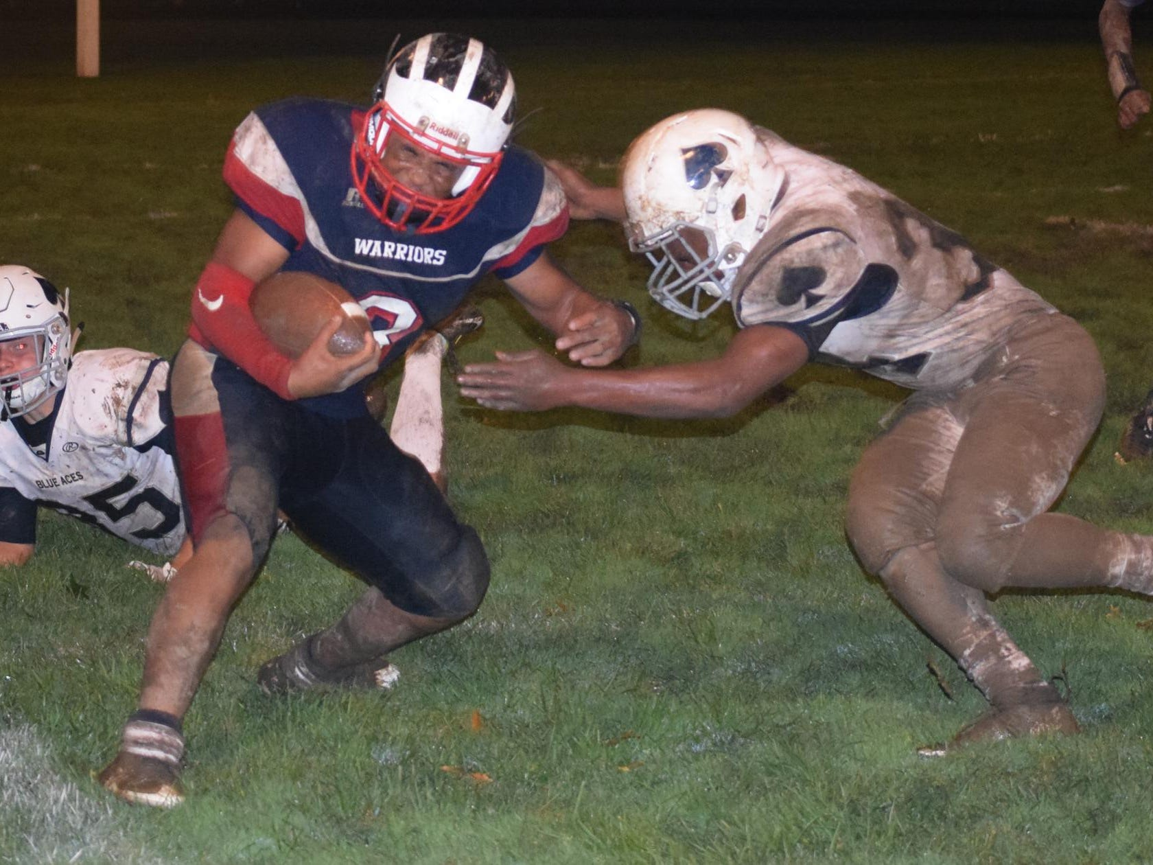 Granville defensive back Thomas McGrath drives Eastmoor Academy's Daylin Jackson out of bounds on a punt return.