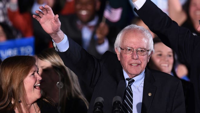 US Democratic presidential candidate Bernie Sanders waves during the primary night rally in Concord, New Hampshire, on February 9. Sanders will hold a rally in Fort Collins Sunday at Colorado State University.