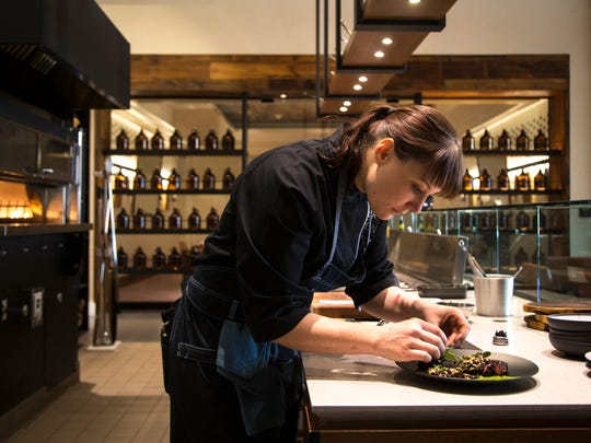 Chef Tandy Peterson plates a dish at Mowry & Cotton
