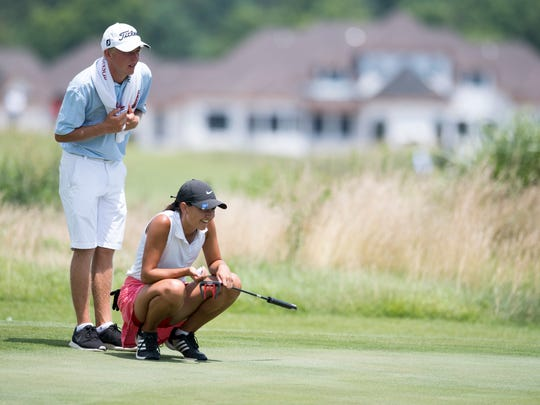 Adam Bratton and Mallory Russell eye a putt on the fifth green during the final round of the Women's City golf tournament at Cambridge Golf Course on Sunday, July 1, 2018.