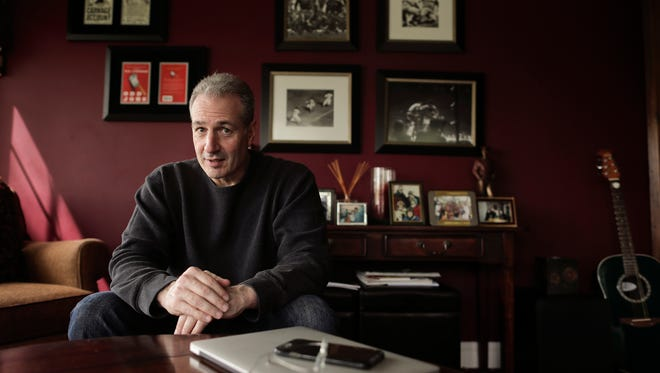 In this Wednesday, May 10, 2017 photo, Ben Lieberman sits for a portrait at his home in Chappaqua, N.Y. After his 19-year-old son, Evan, was killed in a car crash in which the driver of the vehicle he was riding in was texting behind the wheel, Liberman has been working on a proposal that would allow police at accident scenes in New York to immediately examine drivers' cellphones with a device to determine if they'd been tapping, swiping or clicking.
