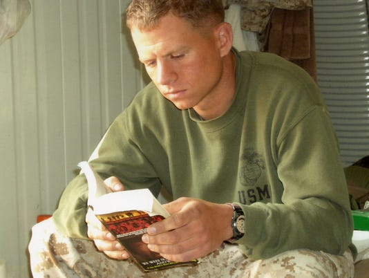 2005-02e-Sgt-Wimberg-with-Book.jpg