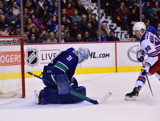 USP NHL: NEW YORK RANGERS AT VANCOUVER CANUCKS S HKN VAN NYR CAN BR