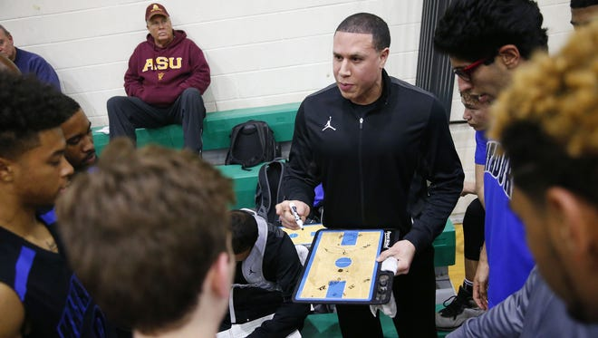 Shadow Mountain head coach Mike Bibby draws up a play for his team against St. Mary's at the St. Mary's High School gym in Phoenix, Ariz. January 24, 2017.