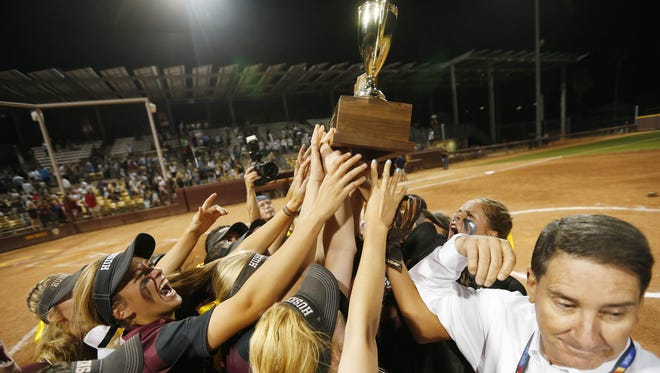 Hamilton High players celebrate their 7-2 victory over Pinnacle, winning the 6A high school softball state championship in Tempe, Ariz. May 15, 2017.