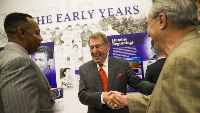 Jerry Colangelo (left) shakes hands with  GCU board member Jack Henry during a reception for the new Jerry Colangelo Museum at Grand Canyon University in Phoenix, Ariz. September 20, 2017. Colangelo turned Phoenix into a major-league sports town, revived USA Basketball and led the renaissance of the area.