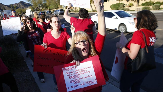 Teachers and supporters protest outside the KTAR studios where Gov. Doug Ducey was a guest in Phoenix, Ariz. March 12, 2018. Teachers are pushing for higher wages.