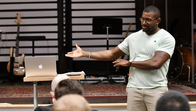 Former MSU football player Chris Norman teaches a Bible study before one of the services at Highland Park Baptist Church in Southfield.