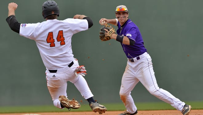 Western Carolina's Brett Pope turns a double-play on Mercer's Hunter Bening during the Southern Conference baseball tournament championship game Sunday May 29, 2016 at Fluor Field.