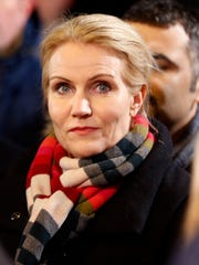 Danish Prime Minister Helle Thorning-Schmidt takes part in a vigil near the cultural club in Copenhagen, Denmark, Monday, Feb. 16, 2015. The slain gunman behind two deadly shooting attacks in Copenhagen was released from jail just two weeks ago and might have become radicalized there last summer, a source close to the Danish terror investigation told The Associated Press on Monday.