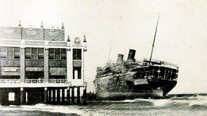 The burned hull of the Morro Castle luxury liner beached itself next to Convention Hall in Asbury Park on Sept. 8, 1934.