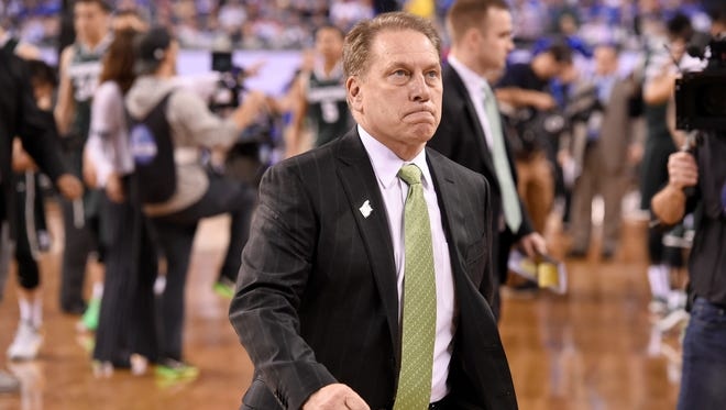 An angry Tom Izzo leaves the court  looking at the scoreboard after the Spartans' loss  to Duke 81-61 in the Final Four in Indianapolis Friday  4/3/2015.