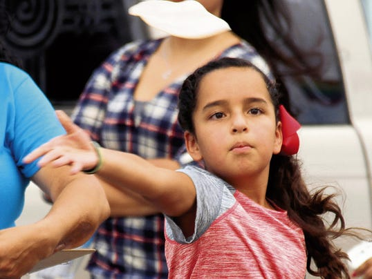 "Kristen Garcia keeps a keen focus on her flying tortilla as she released it ""Frisbee style"" during the World's Richest Tortilla Toss held Saturday at the duck races."