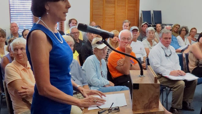 Island Authority board member Karen Sindel and her colleagues are pushing to implement a policy to ensure sublessees receive some discount. The county commissioners approved a minimum 50 percent lease fee reduction that only applies to master leaseholders.