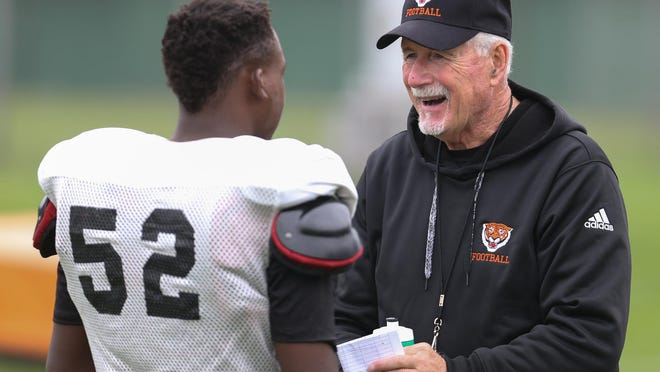 Benton Harbor head football coach Elliot Uzelac talks with Mikel Seals-Porter during practice on Monday October, 5,2015 in Benton Harbor Michigan.