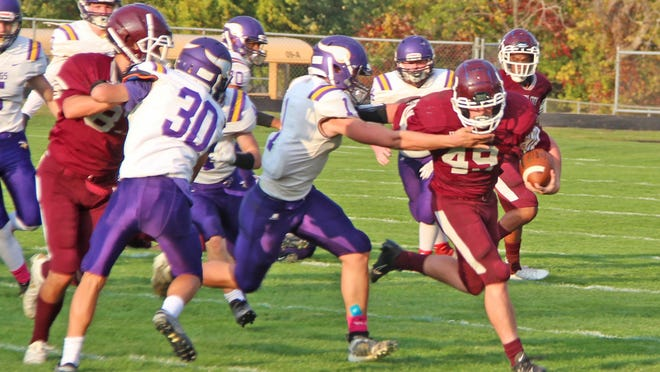 Union City's Garrett Iobe, shown here versus Bronson, rushed for 286 yards and three touchdowns in the Chargers win over Springport Friday.