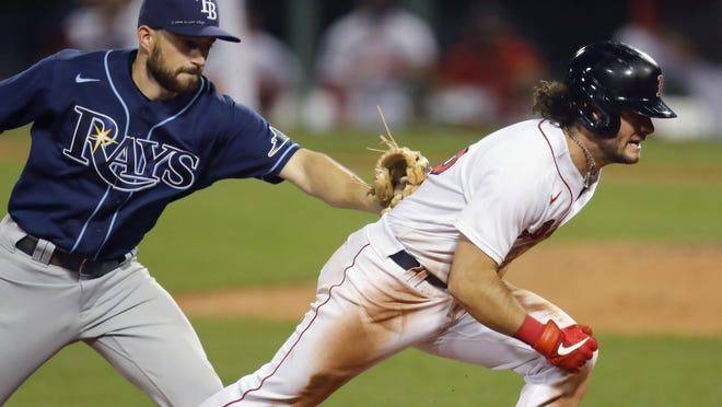 Brandon Lowe runs down Andrew Benintendi and the Red Sox on Tuesday night.