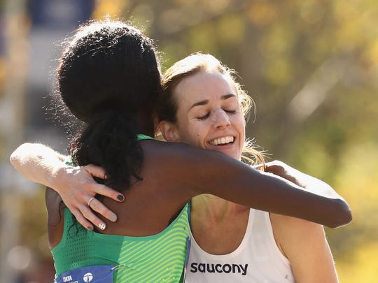 Sally Kipyego of Kenya and Molly Huddle embrace after 2016 New York City Marathon.