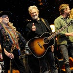 Kris Kristofferson gives a thumbs up after the show finale that included all his guests including Willie Nelson, left, Dierks Bentley, second from right and Jennifer Nettles, right, among many others at The Life and Songs of Kris Kristofferson at Bridgestone Arena on Wednesday.