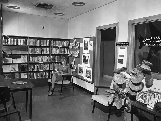 Circa 1962 photo of a flight attendant reading in the Nashville Public Library reading room at Nashville International Airport, the first branch library reading room ever established in a municipal airport.