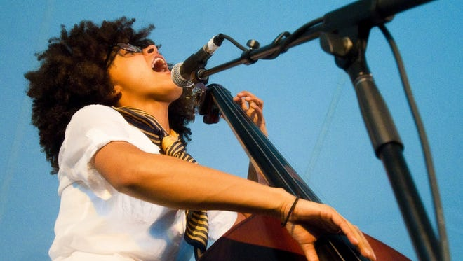 Grammy winner Esperanza Spalding jams on her stand-up bass during her performance at the Summer Solstice Jazz Festival Friday June 19, 2009 in East Lansing.
