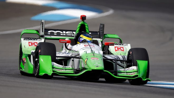Sebastien Bourdais, of France, drives through a turn during practice for the Grand Prix of Indianapolis auto race at the Indianapolis Motor Speedway in Indianapolis, Friday, May 8, 2015.