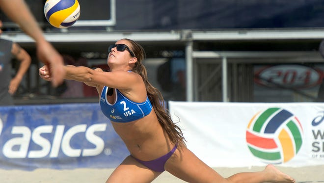 Playing with a torn rotator cuff, FGCU and Canterbury School graduate Brooke Sweat digs a ball at the FIVB World Series of Volleyball in Long Beach, Calif., on Aug. 19.