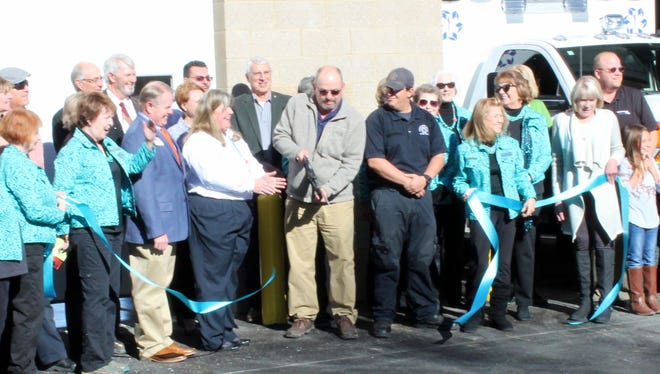 Lincoln County Commissioner and vice chairman Dallas Draper cuts the ribbon to officially open the new Emergency Medical Services base as the first segment of the Lincoln County Medical Center replacement project.