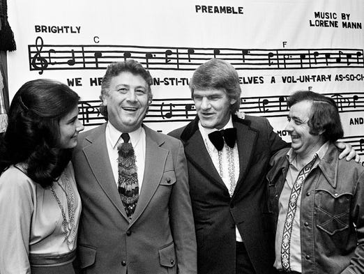 Cowboy Jack Clement, second from left, Harlan Howard, second from right, and two others gather for the Nashville Songwriters Association banquet at the Sheraton South Motor Inn on Oct. 14, 1973. Clement and Howard were inducted into the NSA Hall of Fame along with five others.