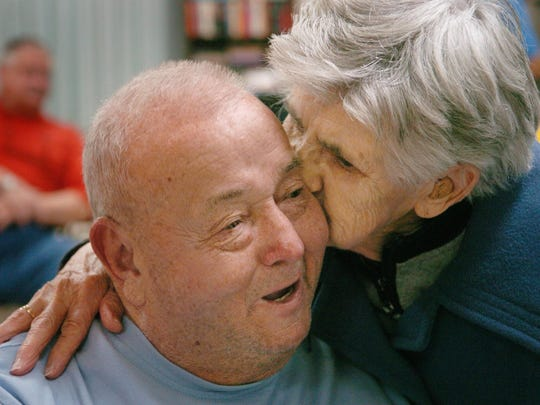 "Robert ""Big Stef"" Steffen gets a kiss from Helen McLafferty in 2008 at a bingo and grillout organized by his charity organization, Big Stef Inc. for senior citizens in Highland Heights. Steffen died in May 2016. He was 78."