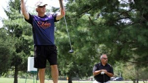 John Bodnar of Madison reacts after he tees off  during the New Jersey Chapter U.S. Lacrosse annual golf outing at Picatinny Arsenal in August 2014. (Tanya Breen/Staff Photographer)
